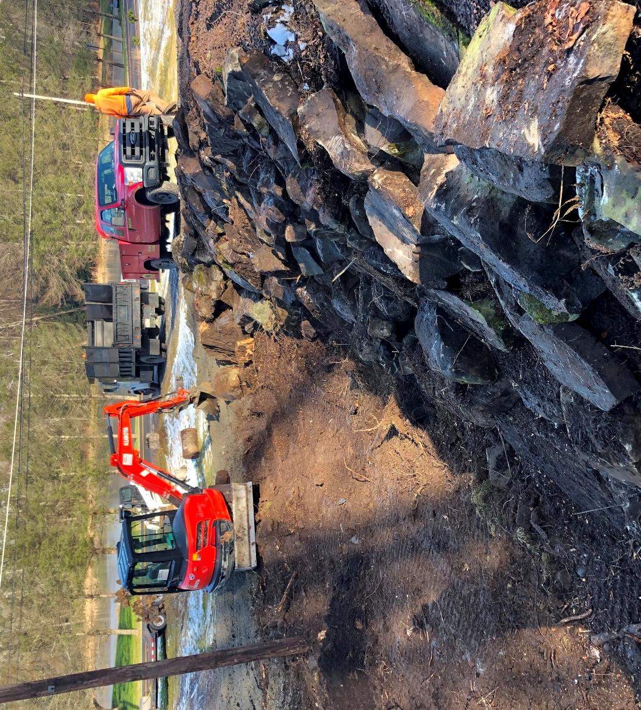 Construction of a PA Bluestone Laid Back Retaining Wall