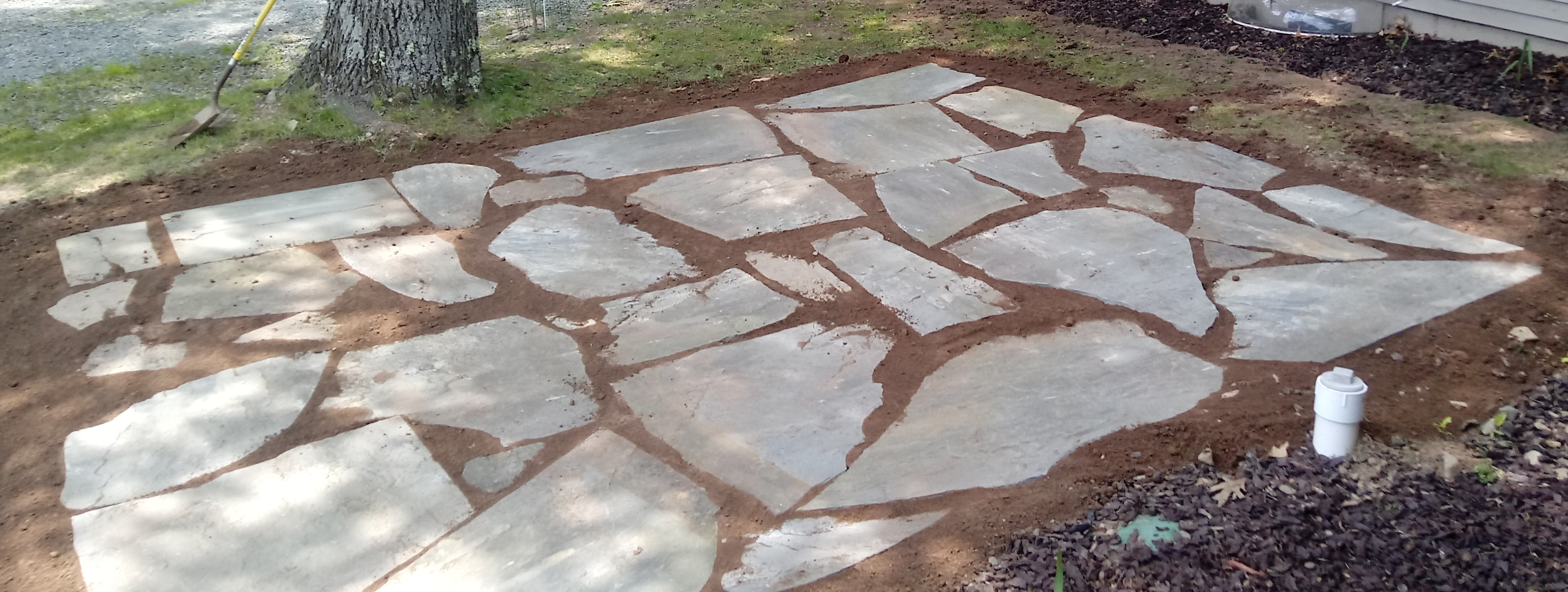 Irregular PA Bluestone Patio by Apple Creek Landscaping LLC