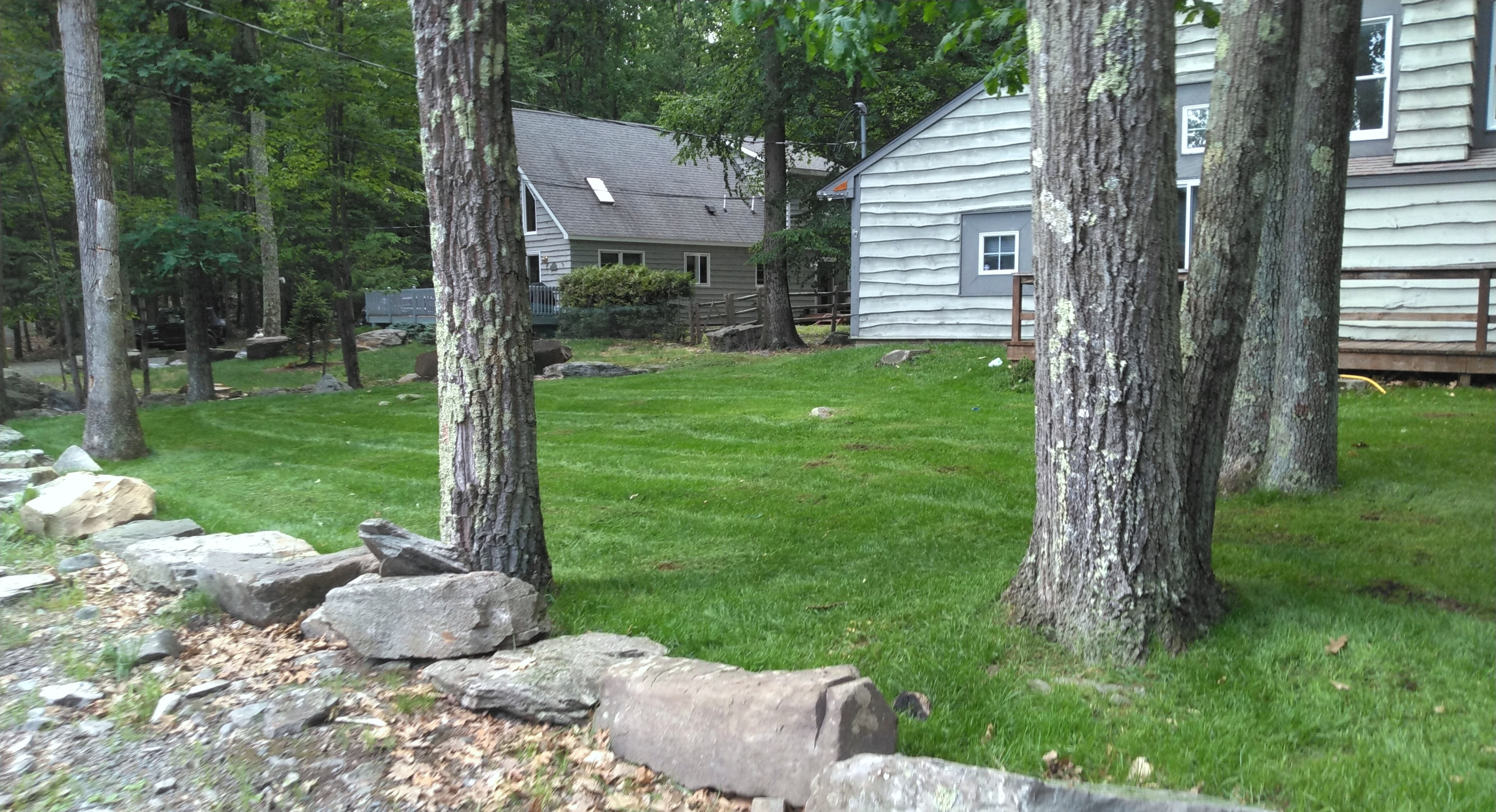 New Lawn Installation with Boulder Border