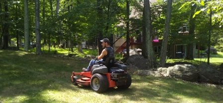 Apple Creek Crewmember Mowing